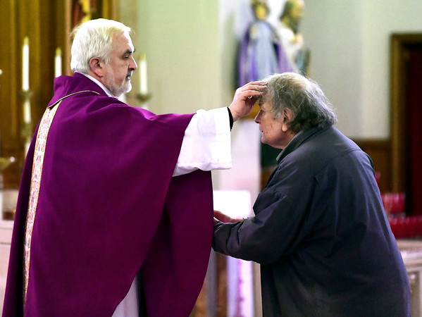 3/6/2019 Mike Orazzi | Staff St Stanislaus Roman Catholic Rev. Tomasz Sztuber applies ashes to Ken Marek during Ash Wednesday Mass in Bristol.