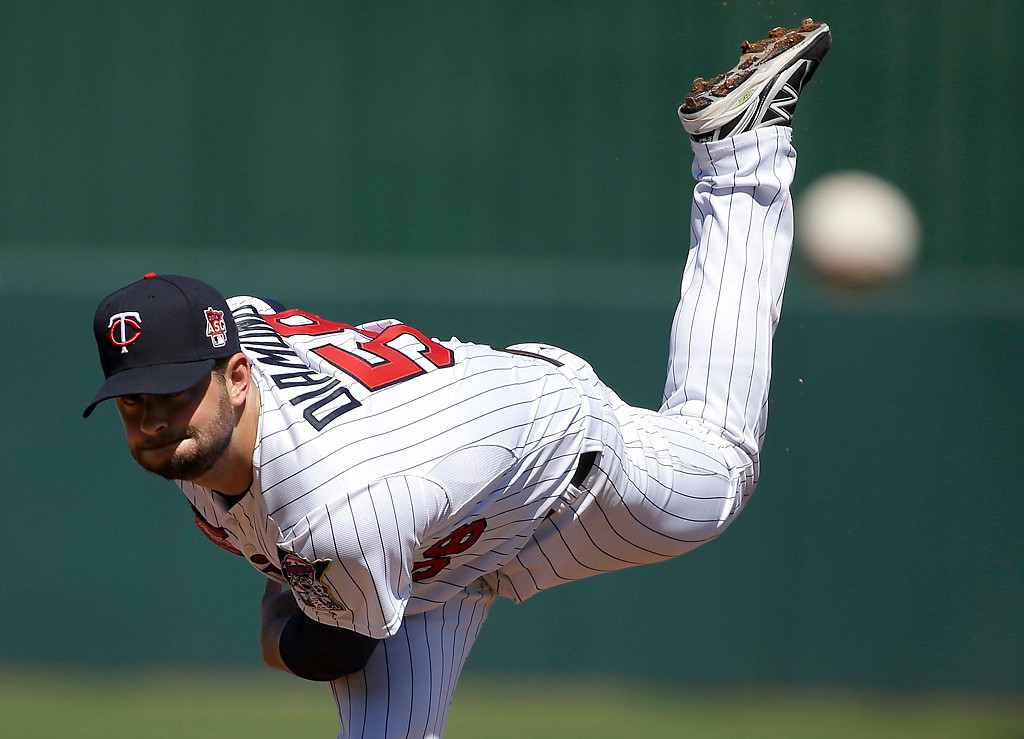 . Minnesota Twins pitcher Scott Diamond delivers a warm-up throw in the first inning of an exhibition baseball game against the Boston Red Sox, Saturday, March 1, 2014, in Fort Myers, Fla. The Twins beat the Red Sox 6-2. (AP Photo/Steven Senne)