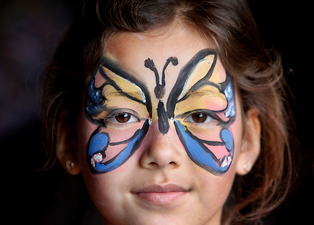 """. Seven-year-old Zoe Nguyen shows off her butterfly face paint at Hakone Estate and Gardens Lunar New Year of the Snake festival with a \""""Chinese Village Fair\"""" on Sunday afternoon, March 3, 2013 in Saratoga, Calif. (Karl Mondon/Staff)"""