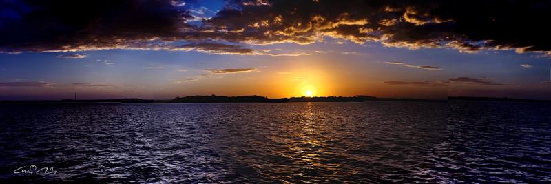 Dramatic ocean sunset panorama.