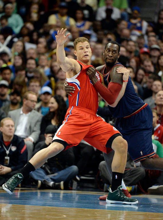 . Los Angeles Clippers forward Blake Griffin (32) and Denver Nuggets center J.J. Hickson (7) battle for position away from the ball during the first quarter. (Photo by John Leyba/The Denver Post)