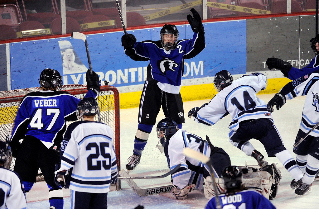 . DENVER, CO. - FEBRUARY 28: Cougars defenseman Russell Pavsek (2) celebrated his tip-in goal on a power play in the second period. Ralston Valley High School took on Resurrection Christian Thursday night, February 28, 2013 in a semifinal match in the Colorado State Ice Hockey Championships at Magness Arena in Denver. (Photo By Karl Gehring/The Denver Post)