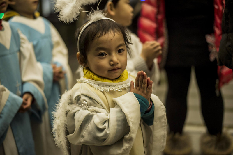 . A young Chinese worshipper attends the Christmas Eve mass at a Catholic church in Beijing on December 24, 2014 as Christians around the world prepare to celebrate the holy day.  FRED DUFOUR/AFP/Getty Images