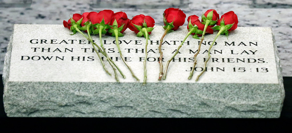 . Roses lie on a memorial marker honoring the Mississippi Department of Public Safety law enforcement agencies officers killed in the line of duty, Tuesday, May 15, 2018, during a fallen officers memorial service at department headquarters in Jackson, Miss. (AP Photo/Rogelio V. Solis)