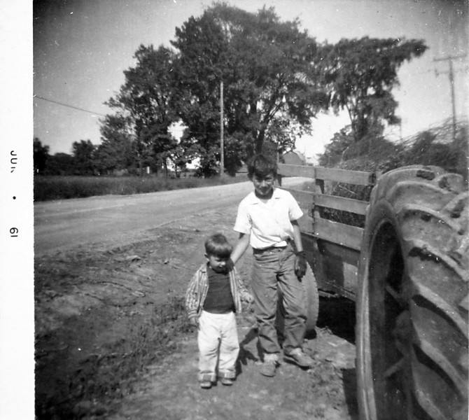 George showing Norm the tractor.JPG