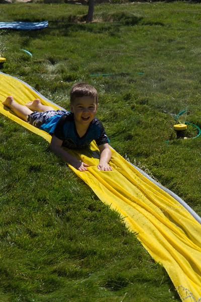 August 2015 - Caleb and Olivia on the Slip-n-Slide