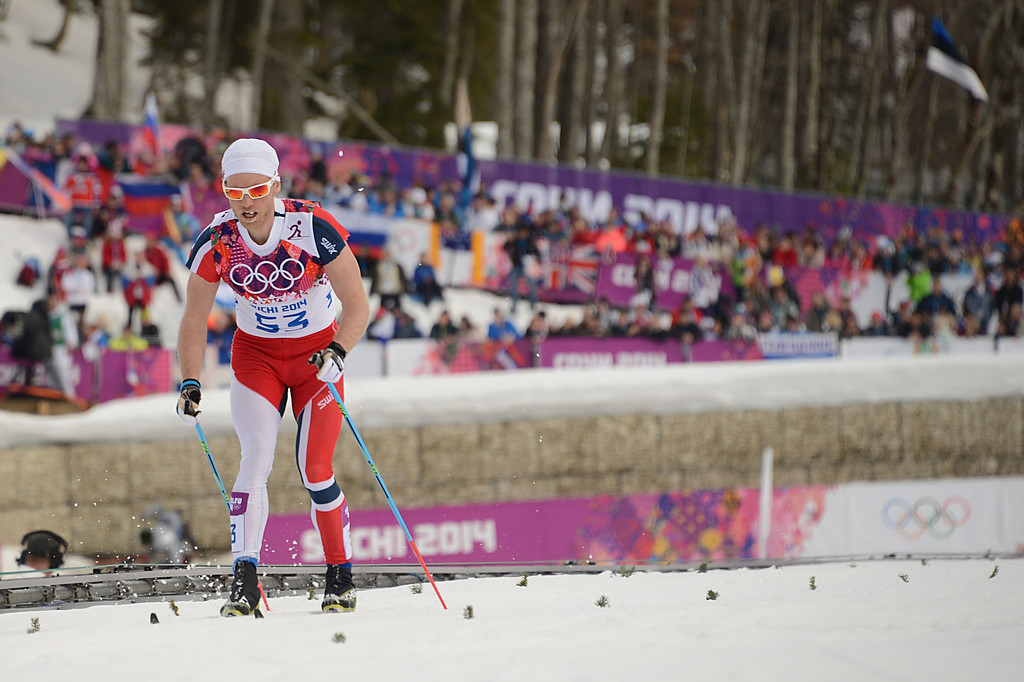 . Norway\'s Martin Johnsrud Sundby reaches the finish line in the Men\'s Cross-Country Skiing 15km Classic at the Laura Cross-Country Ski and Biathlon Center during the Sochi Winter Olympics on February 14, 2014 in Rosa Khutor near Sochi.  The tough men\'s 15 km classic time trial saw apparel not usually associated with skiing, with many competitors wearing just T-shirts instead of the normal long-sleeves while others even bared their legs. AFP PHOTO / KIRILL KUDRYAVTSEV/AFP/Getty Images