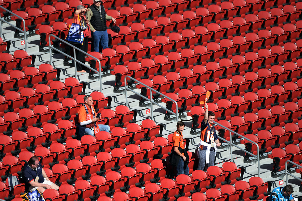 . SANTA CLARA, CA - FEBRUARY 7: A Broncos fan waves his towel as other fans arrive prior to the start of the game.  The Denver Broncos played the Carolina Panthers in Super Bowl 50 at Levi\'s Stadium in Santa Clara, California on February 7, 2016. (Photo by RJ Sangosti/The Denver Post)