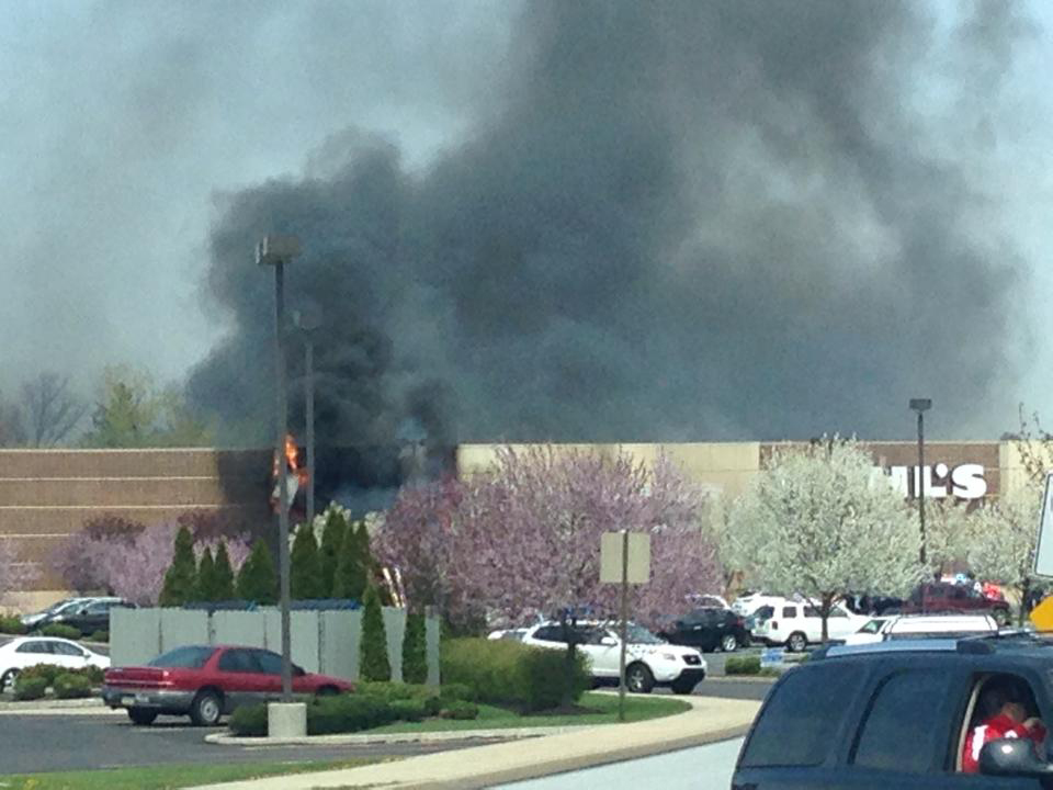 Description of . Fire damages the front of the Kohl's Department Store in Limerick, Pa., on Friday, April 25, 2014. (Photo by Dan Reischel)
