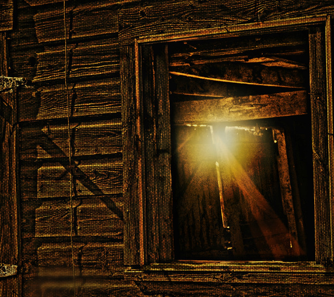 BARN WINDOW WITH GLOW FROM DOOR