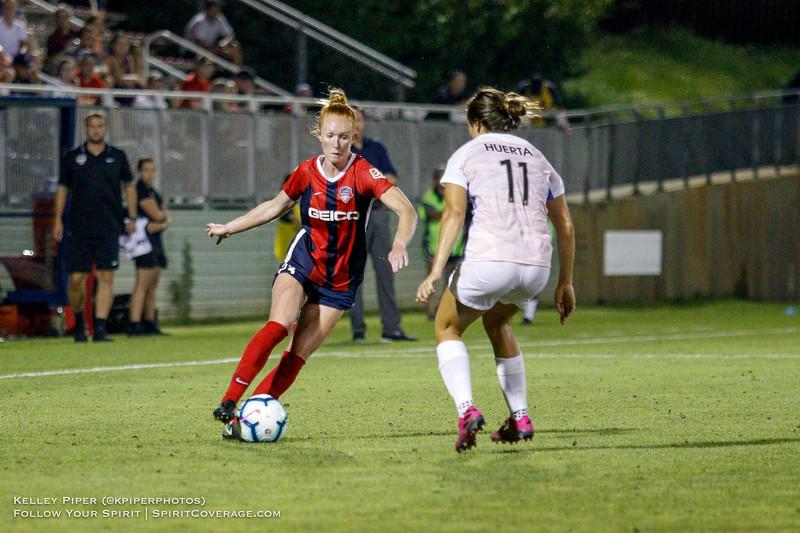 Washington Spirit defender Tori Huster (23) goes up against Houston Dash midfielder Sofia Huerta (11) at Maureen Hendricks Field in Boyds, MD, on July 20, 2019.