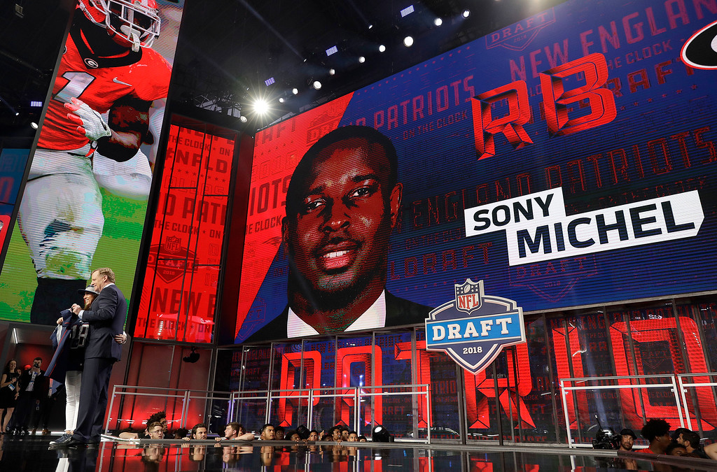 . Commissioner Roger Goodell poses with a fan after the New England Patriots selected Georgia\'s Sony Michel during the first round of the NFL football draft, Thursday, April 26, 2018, in Arlington, Texas. (AP Photo/David J. Phillip)