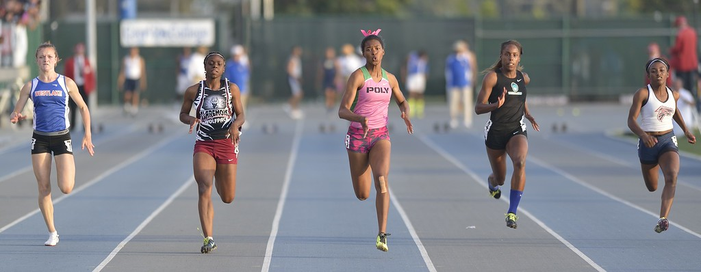 . NORWALK, CALIF. USA -- Poly\'s Arianna Washington, center, competes in the 400 meter dash with Westlake\'s Abigail Smith, left, Claremont\'s Brittany Brown, Aliso Niguel\'s Danielle Dardon and La Quinta\'s Kayla Wilson during the CIF-SS Masters Track and Field Meet in Norwalk, Calif., on Friday, May 24, 2013. Photo by Jeff Gritchen / Los Angeles Newspaper Group