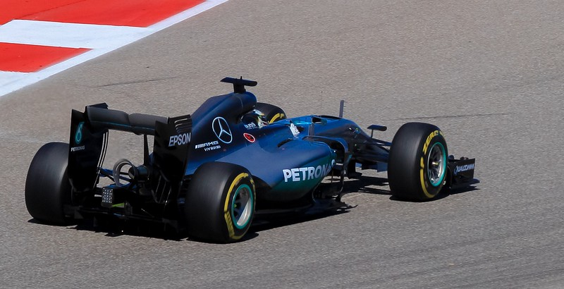 High lateral forces distort the tires on World Champion Lewis Hamilton's Mercedes.