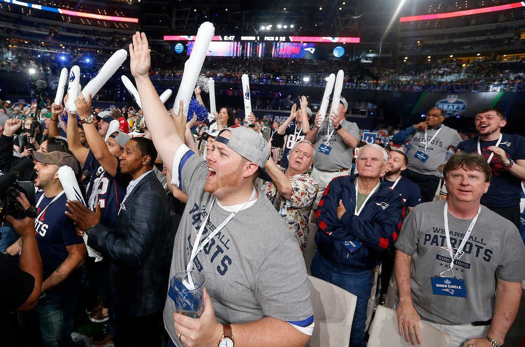 . New England Patriots fans cheer during the first round of the NFL football draft, Thursday, April 26, 2018, in Arlington, Texas. (AP Photo/Michael Ainsworth)