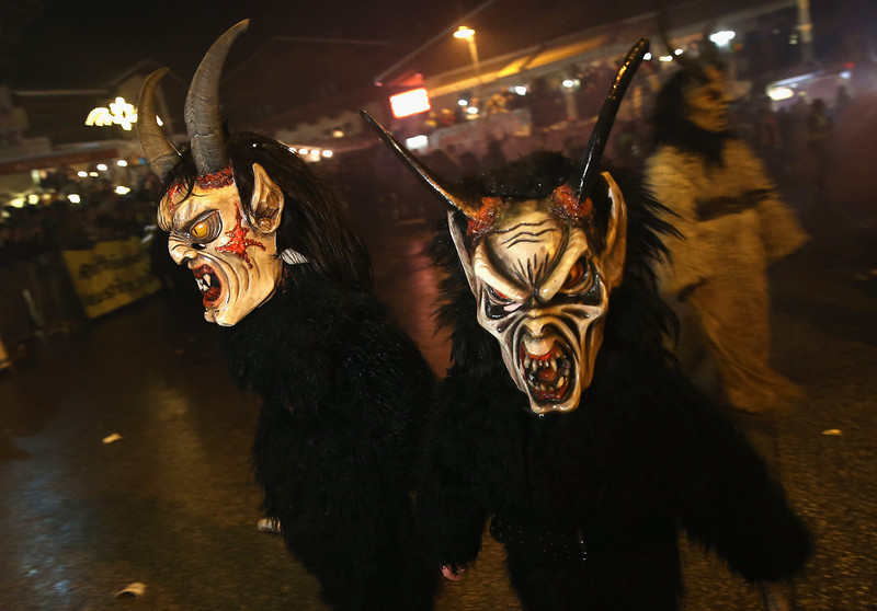 . Participants dressed as the Krampus creature walk the streets in search of delinquent children during Krampus night on November 30, 2013 in Neustift im Stubaital, Austria. Sixteen Krampus groups including over 200 Krampuses participated in the first annual Neustift event. Krampus, in Tyrol also called Tuifl, is a demon-like creature represented by a fearsome, hand-carved wooden mask with animal horns, a suit made from sheep or goat skin and large cow bells attached to the waist that the wearer rings by running or shaking his hips up and down. Krampus has been a part of Central European, alpine folklore going back at least a millennium, and since the 17th-century Krampus traditionally accompanies St. Nicholas and angels on the evening of December 5 to visit households to reward children that have been good while reprimanding those who have not. However, in the last few decades Tyrol in particular has seen the founding of numerous village Krampus associations with up to 100 members each and who parade without St. Nicholas at Krampus events throughout November and early December.  (Photo by Sean Gallup/Getty Images)