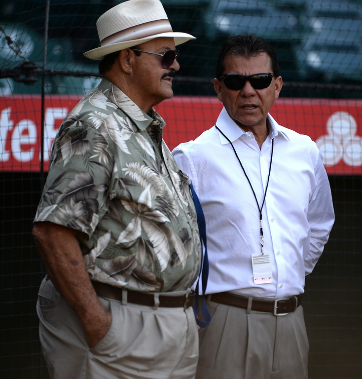 . Los Angeles Dodgers Spanish-language broadcaster Pepe Yñiguez, right, talks with Dodoger scout Mike Brito prior to a baseball game at Anaheim Stadium in Anaheim, Calif., on Thursday, Aug. 7, 2014.  (Photo by Keith Birmingham/ Pasadena Star-News)
