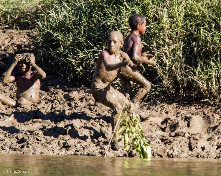 Kids playing in mud at Kwatu Lodge, Papua New Guinea (10-12-2013) 017-275.jpg