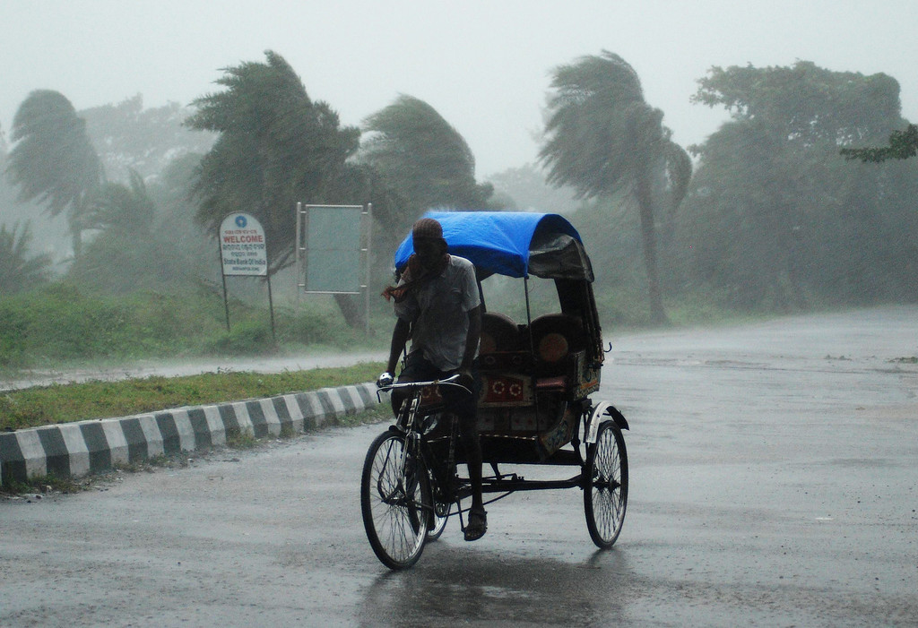 . An Indian rickshaw man bikes through heavy rain in Berhampur, about 180 kilometres south from eastern city Bhubaneswar on October 12, 2013.   Nearly half a million people have been evacuated from India\'s impoverished east coast ahead of a massive cyclone expected to make landfall on October 12 evening, disaster officials said. ASIT KUMAR/AFP/Getty Images