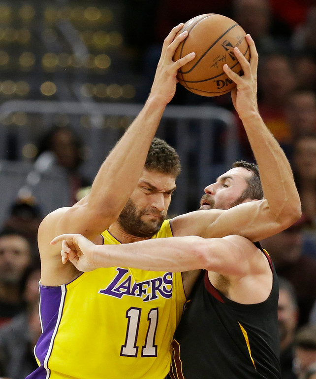 . Los Angeles Lakers\' Brook Lopez (11) is called for the foul against Cleveland Cavaliers\' Kevin Love (0) in the first half of an NBA basketball game, Thursday, Dec. 14, 2017, in Cleveland. (AP Photo/Tony Dejak)