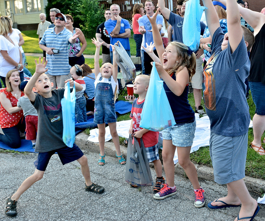. Children reach up for thrown candy during the 2015 Fairport Mardi Gras Parade. The 2017 event is June 30 through July 4. For more information, visit fairportmardigras.vpweb.com. (News-Herald file)