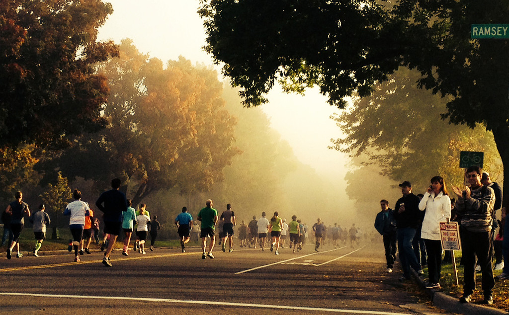 . TC 10 milers run through an early morning mist along Summit Avenue in St. Paul.  (Pioneer Press: John Brewer)