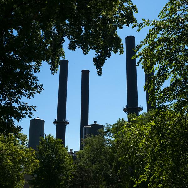 Low angle view of industrial smokestacks, Minneapolis, Hennepin County, Minnesota, USA