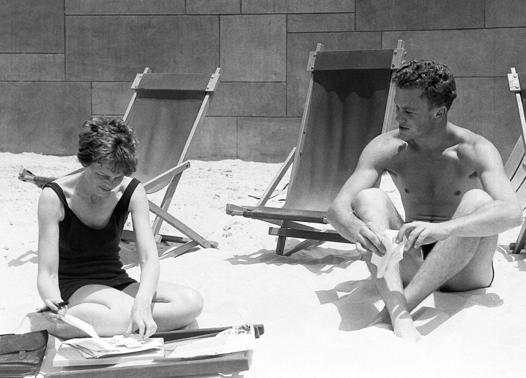 . Amelia Earhart, the Trans-Atlantic flyer, and her Stepson, Dave Putman, photographed on the beach on July 9, 1932 at Los Angeles, California, a short time after their arrival there by plane recently from New York. Miss Earhart? husband accompanied them on the flight. (AP Photo)
