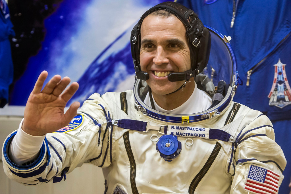 . U.S. astronaut Rick Mastracchio smiles during space suit test prior to blast off to the International Space Station (ISS) from the Russian-leased Baikonur cosmodrome in Kazakhstan early on November 7, 2013. Russia on November 7 launched into space a trio of Russian, Japanese and US astronauts carrying an unlit Olympic torch that will for the first time be taken on a spacewalk to mark the 2014 Winter Games in Sochi.  The Soyuz-FG rocket and Soyuz-TMA capsule, emblazoned with the symbols of the Sochi Games and the Olympic rings, blasted off for the International Space Station (ISS) from Baikonur.    AFP PHOTO/ POOL / SHAMIL ZHUMATOV/AFP/Getty Images