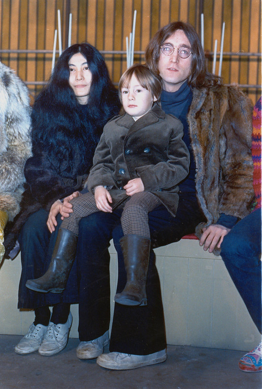 """. In this1968 file photo member of British pop band The Beatles John Lennon poses with his son Julian, sitting on his lap, and  Yoko Ono at an unknown location in 1968. The woman who as a child was the basis for the Beatles song \""""Lucy in the Sky with Diamonds\"""" is gravely ill.  It was thought by many at the time that the psychedelic song from Sgt. Pepper\'s Lonely Heart Club Band was a paean to LSD because of the initials in the title, but it was actually based on a drawing that John Lennon\'s young son Julian brought home from school. He told his father the drawing was of Lucy in the sky with diamonds.  Lucy Vodden,  living in Surrey just outside of London _ drifted apart after schoolyard days, but they have gotten back in touch as Lennon has tried to help Vodden cope with Lupus, a life-threatening disease. (AP Photo)"""