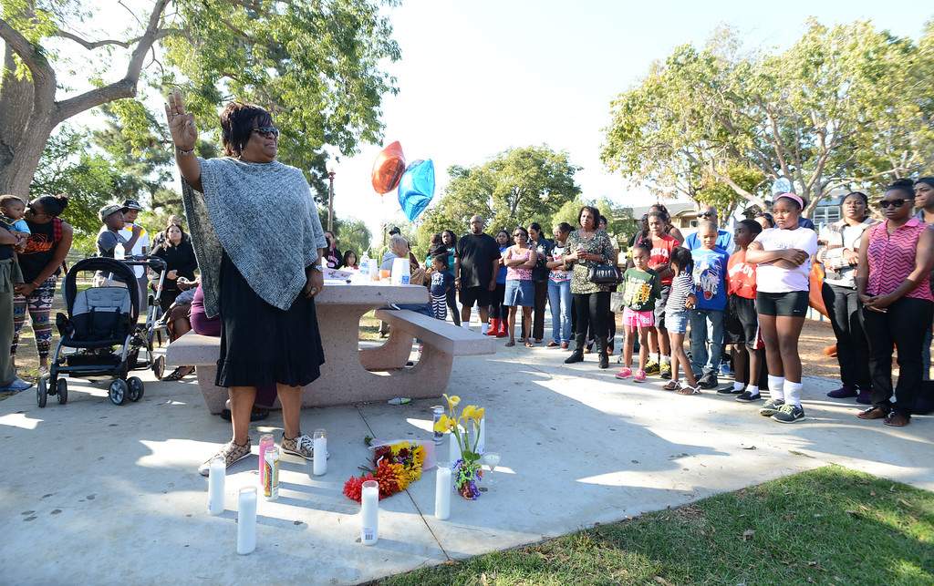 . Long Beach, Calif., -- 10-12-13- Tammy Henry at the spot where her sister and teacher Kellye Taylor,53, was fatally  stabbed in front of her students, at Orizaba Park  Friday October 11th 2013. Friends and family gathered at the park Saturday afternoon.    Stephen Carr/  Daily Breeze