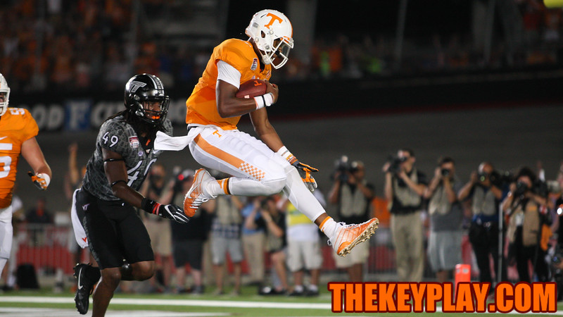Vols QB Joshua Dobbs leaps into the endzone to cap off a strong comeback by Tennesee in the second quarter. (Mark Umansky/TheKeyPlay.com)