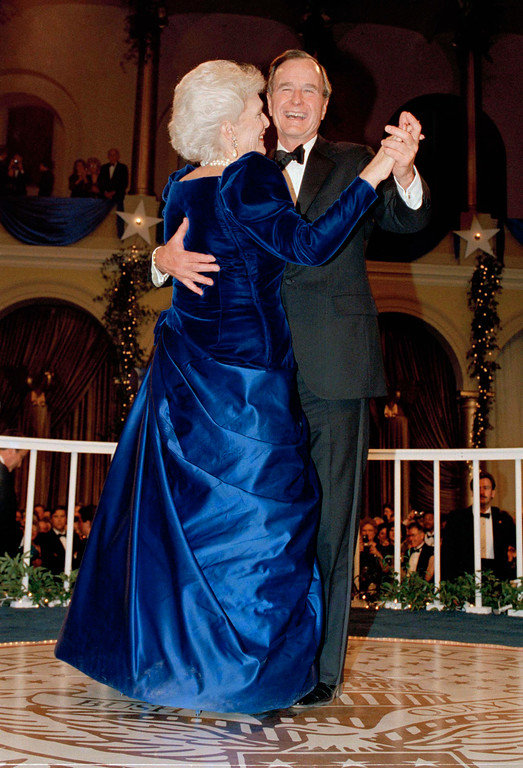 . President  George H.W. Bush and wife, Barbara dance at the inaugural ball at the Pension Building in Washington, on Friday, Jan. 20, 1989. (AP Photo/Scott Applewhite)