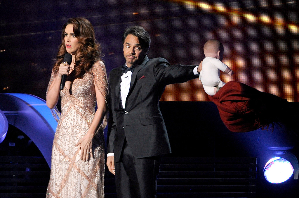 . Hosts Jacqueline Bracamontes, left, and Eugenio Derbez speak on stage at the 15th annual Latin Grammy Awards at the MGM Grand Garden Arena on Thursday, Nov. 20, 2014, in Las Vegas. (Photo by Chris Pizzello/Invision/AP)
