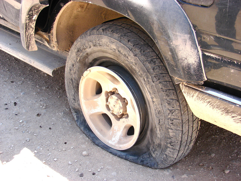 A flat tire in the middle of the desert