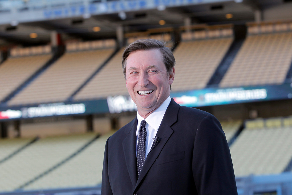 . Former NHL player, Wayne Gretzky speaks about the Dodger Stadium upcoming 2014 NHL Stadium Series hockey game in Los Angeles, on Monday, Jan. 13, 2014.  (AP Photo/Nick Ut)