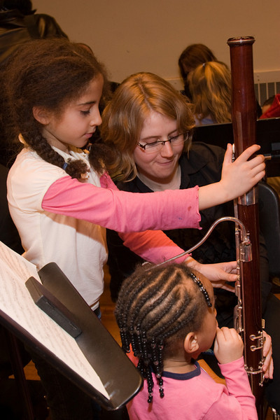 Katie Clark, bassoon, with child -- Hopkins Symphony Orchestra, March 2008