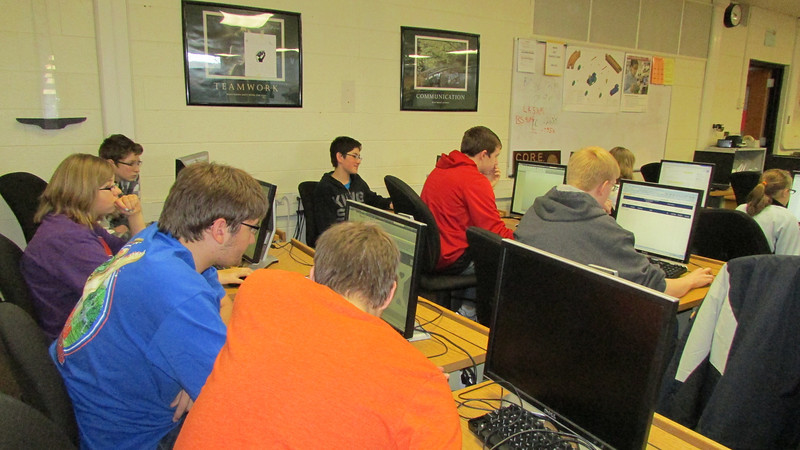 Subteams work on their projects in the computer lab.