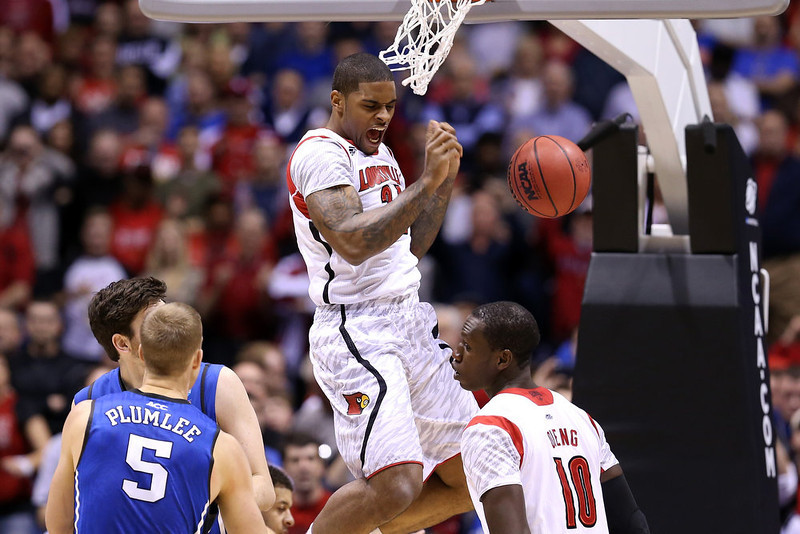 . Chane Behanan #21 of the Louisville Cardinals reacts after he dunked the ball against the Duke Blue Devils during the Midwest Regional Final round of the 2013 NCAA Men\'s Basketball Tournament at Lucas Oil Stadium on March 31, 2013 in Indianapolis, Indiana.  (Photo by Streeter Lecka/Getty Images)