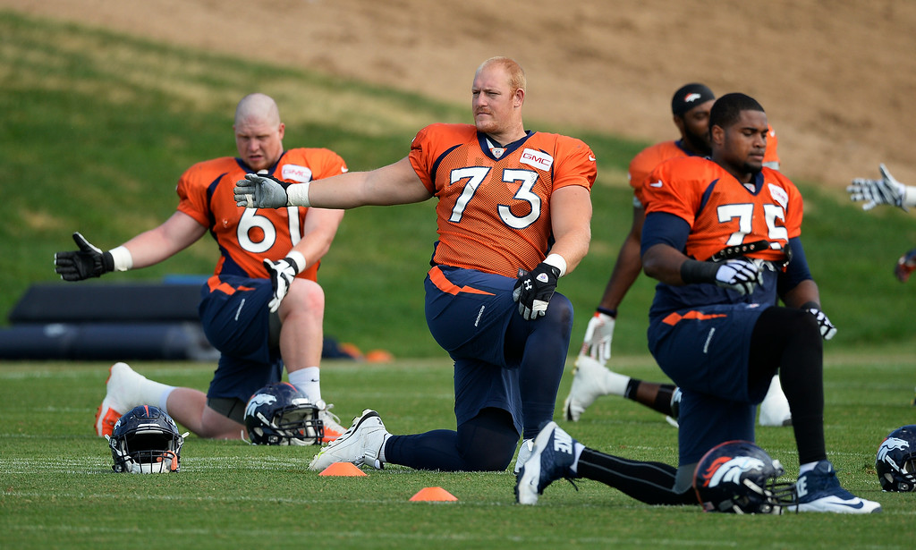 . Denver Broncos offensive guard Ryan Miller (73) stretches on day 12 of the Denver Broncos 2014 training camp August 5, 2014 at Dove Valley. (Photo by John Leyba/The Denver Post)