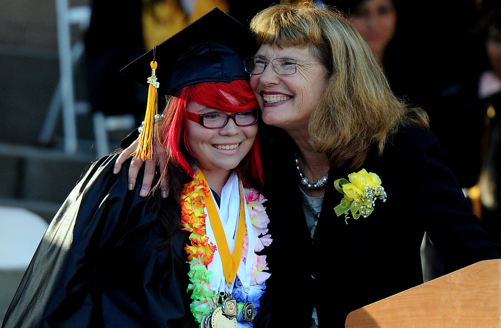 . Principal Suzette Montano, right, hugs graduate Desiry M. Alaniz during the Vail High School commencement at Vail High School on Tuesday, June 18, 2013 in Montebello, Calif.