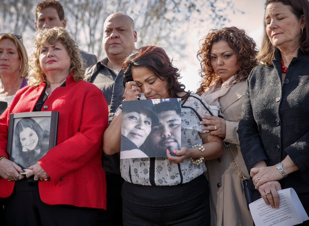 . Rosie Cortinas, center, holds a photo of her son Amador Cortinas of Homedale, Idaho, who was killed on Oct. 18, 2013, while driving a friend home in a Chevy Cobalt, joins other families whose loved ones died behind the wheel of defective General Motors vehicles plagued by a defective ignition switch linked to 13 deaths and dozens of crashes, during a news conference on Capitol Hill in Washington, Tuesday, April 1, 2014. The House Energy and Commerce Subcommittee on Oversight and Investigations will look for answers today from GM CEO Mary Barra about a faulty ignition switch and mishandled recall of 2.6 million cars that�s been linked to 13 deaths and dozens of crashes.  At far right is Rep. Diana DeGette, D-Colo., the ranking member of that subcommittee.  (AP Photo/J. Scott Applewhite)