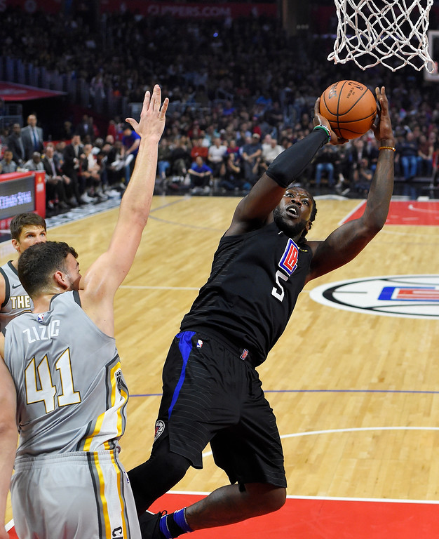 . Los Angeles Clippers forward Montrezl Harrell, right, shoots as Cleveland Cavaliers forward Ante Zizic, of Croatia, defends during the first half of an NBA basketball game Friday, March 9, 2018, in Los Angeles. (AP Photo/Mark J. Terrill)