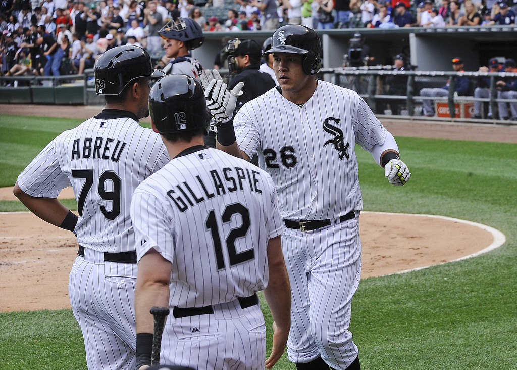 . Chicago White Sox\'s Avisail Garcia celebrates with teammate Jose Abreu as Conor Gillaspie looks on after hitting hit a three-run home run during the first inning of a baseball game against the Detroit Tigers in Chicago on Sunday, June 7, 2015. (AP Photo/Matt Marton)