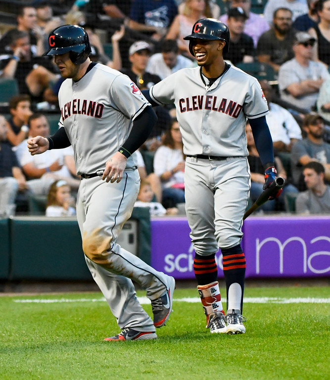 . Cleveland Indians\' Roberto Perez, left, celebrates with Francisco Lindor after Perez scored against the Chicago White Sox during the fifth inning of a baseball game Saturday, Aug. 11, 2018, in Chicago. (AP Photo/Matt Marton)