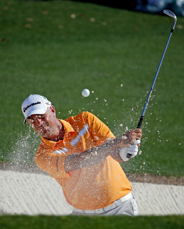 . Stewart Cink hits out of a bunker on the 18th hole during the third round of the Masters golf tournament Saturday, April 12, 2014, in Augusta, Ga. (AP Photo/Matt Slocum)