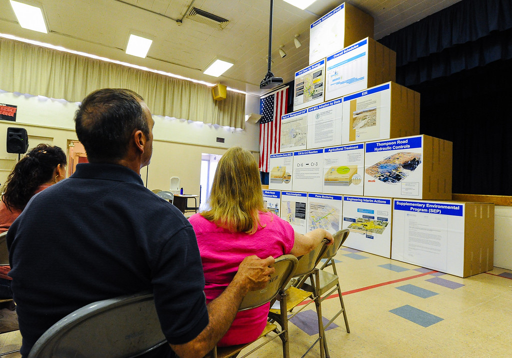 """. Husband and wife Rick and Sherry Powell, who are 10-year Hinkley residents, study a pyramid visually representing PG&E\'s Hinkley remediation strategy process over time during a Community Advisory Committee meeting in the Hinkley School auditorium in Hinkley, Calif. on Thursday, June 27, 2013. \""""I turned to my husband and said, \'The plan looks like gothiath.\' And staring at it we feel like David � it\'s sad,\"""" Sherry said. (Rachel Luna / San Bernardino Sun)"""