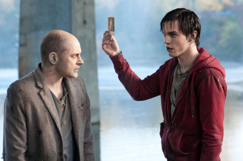 ". This film image released by Summit Entertainment shows Rob Corddry, left, and Nicholas Hoult in a scene from ""Warm Bodies.\"" (AP Photo/Summit Entertainment, Jonathan Wenk)"
