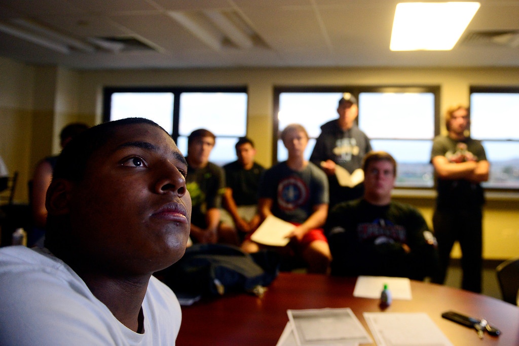 . Valor Christian starting right tackle Isaiah Holland listens during an offensive line meeting. (Photo by AAron Ontiveroz/The Denver Post)