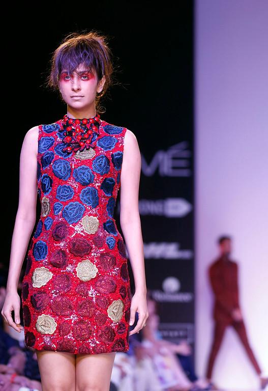 . A model displays a creation by Narendra Kumar during the Lakme Fashion Week in Mumbai, India, Wednesday,  March 12, 2013. (AP Photo/Rajanish Kakade)